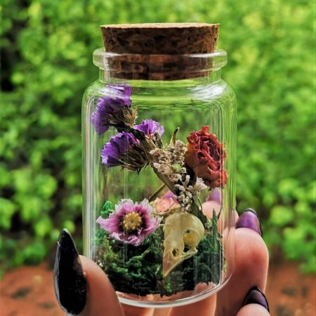 Dried flowers and skull glass jar